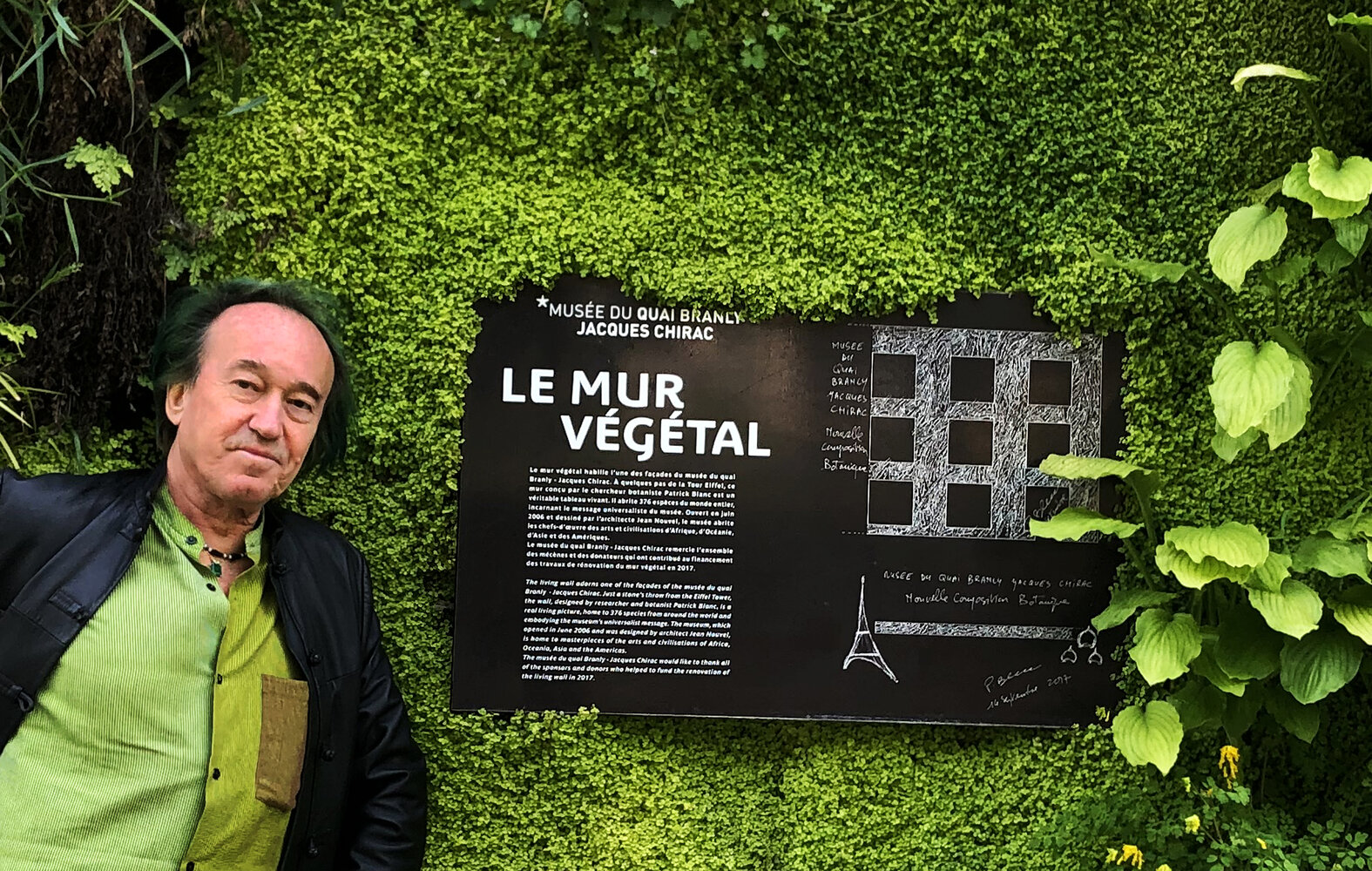 Patrick Blanc and the billboard explaining the concept of his vertical garden at the Quai Branly - Jacques Chirac Museum, Paris, May 2020. Copyright Pascal Heni.